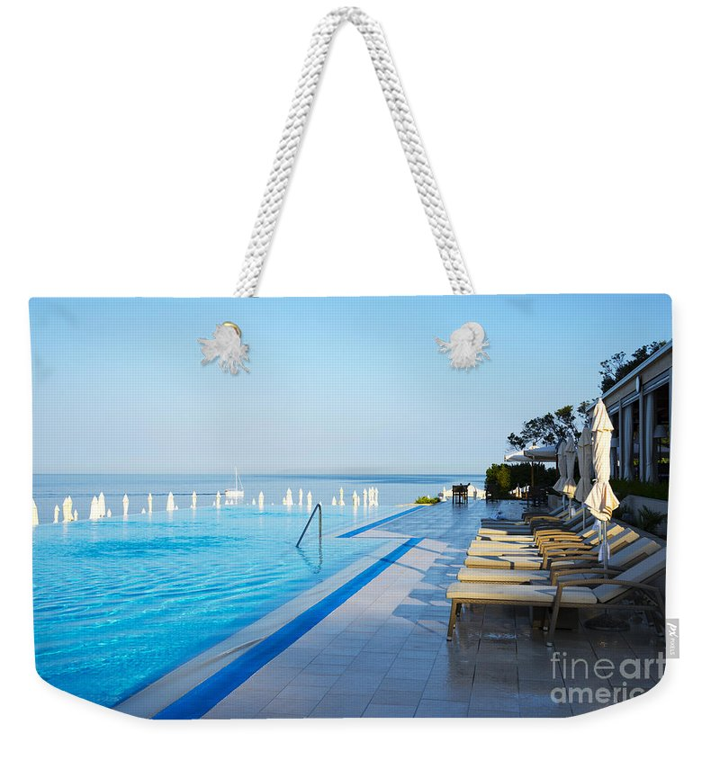 Bay Weekender Tote Bag featuring the photograph Infinity Pool by Svetlana Sewell