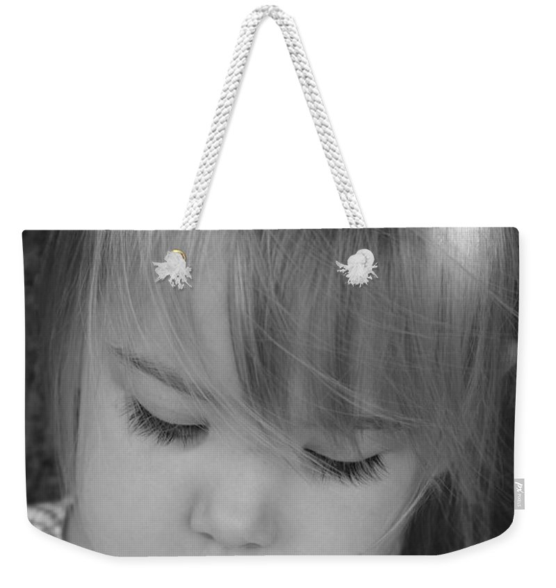 Angelic Weekender Tote Bag featuring the photograph Innocence by Margie Wildblood