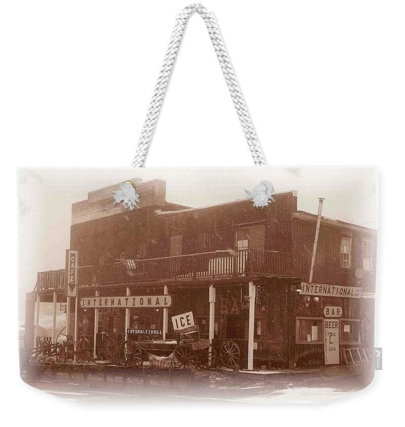 Internatonal Cafe Weekender Tote Bag featuring the photograph International Cafe by Nelson Strong