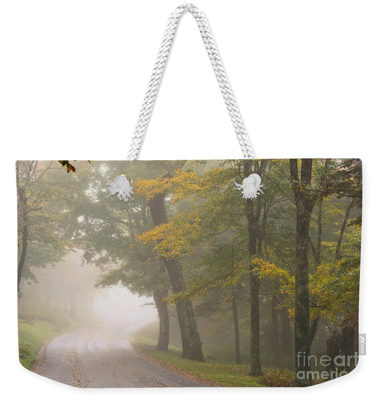 Grandfather Mountain Weekender Tote Bag featuring the photograph Down The Mountain, Into The Fog by Dianne Sherrill