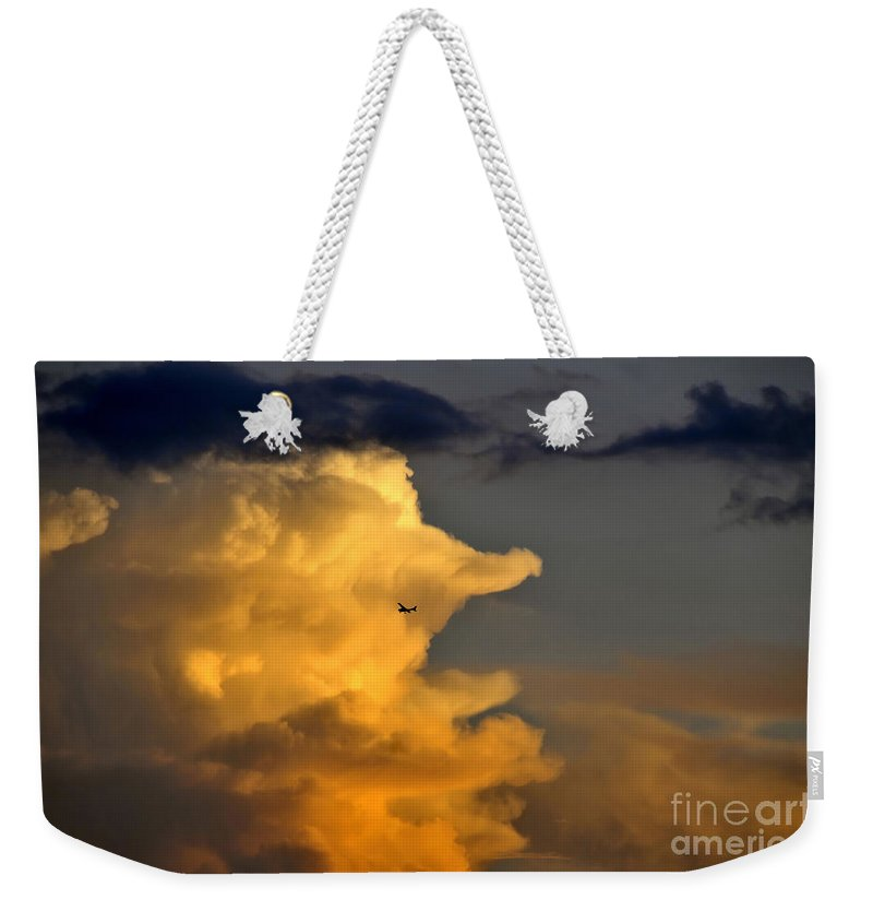 Flying Weekender Tote Bag featuring the photograph Into The Storm by David Lee Thompson