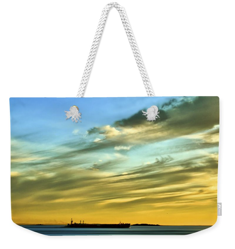 Sunset Weekender Tote Bag featuring the photograph Into The Sunset by Evelina Kremsdorf