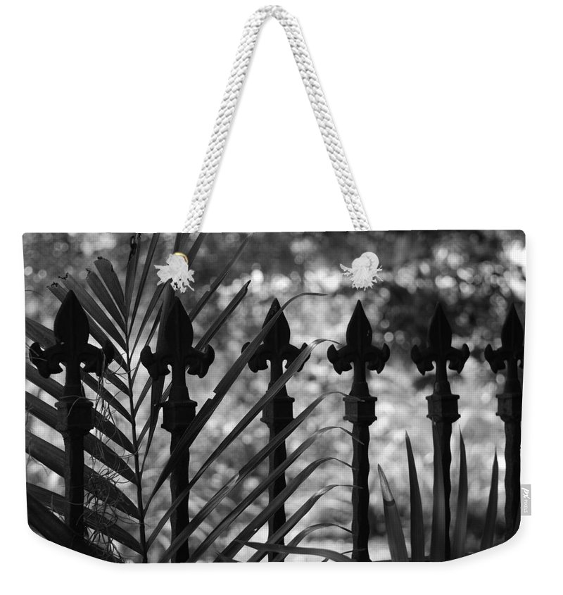 Wrought Iron Weekender Tote Bag featuring the photograph Iron Fence by Rob Hans
