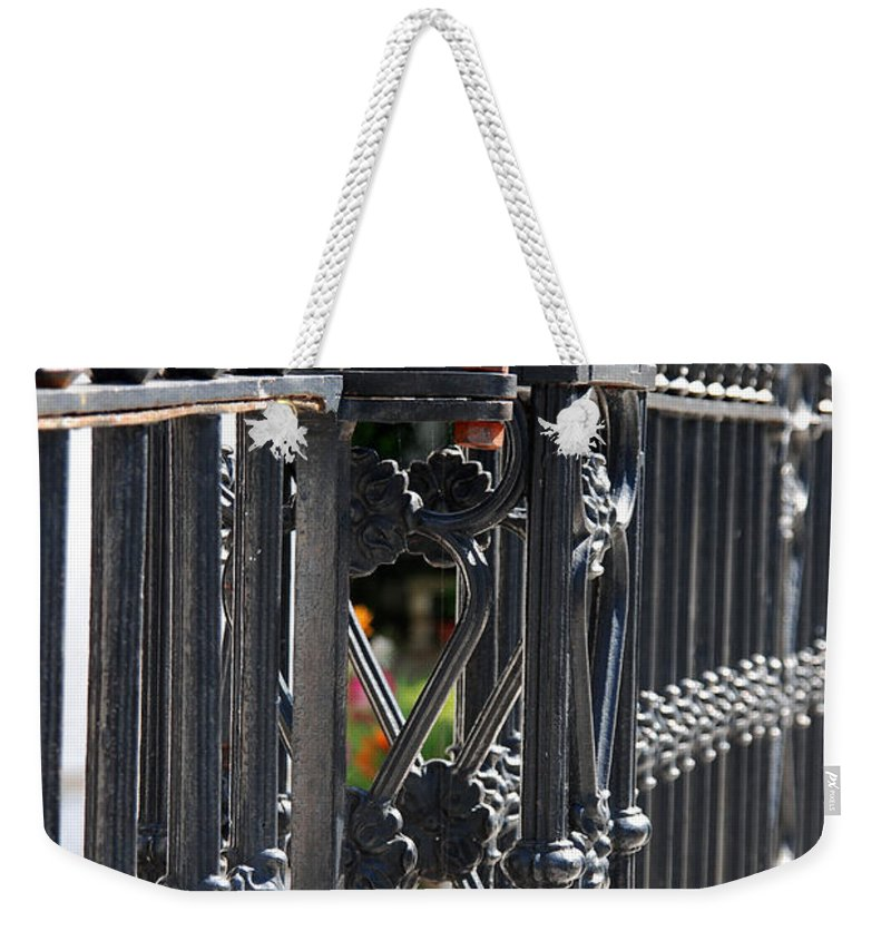 Iron Fence Weekender Tote Bag featuring the photograph Iron Fence by Susanne Van Hulst