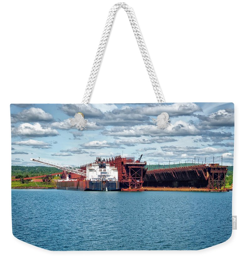 Americas Weekender Tote Bag featuring the photograph Iron Ore Loading Onto Laker by Roderick Bley