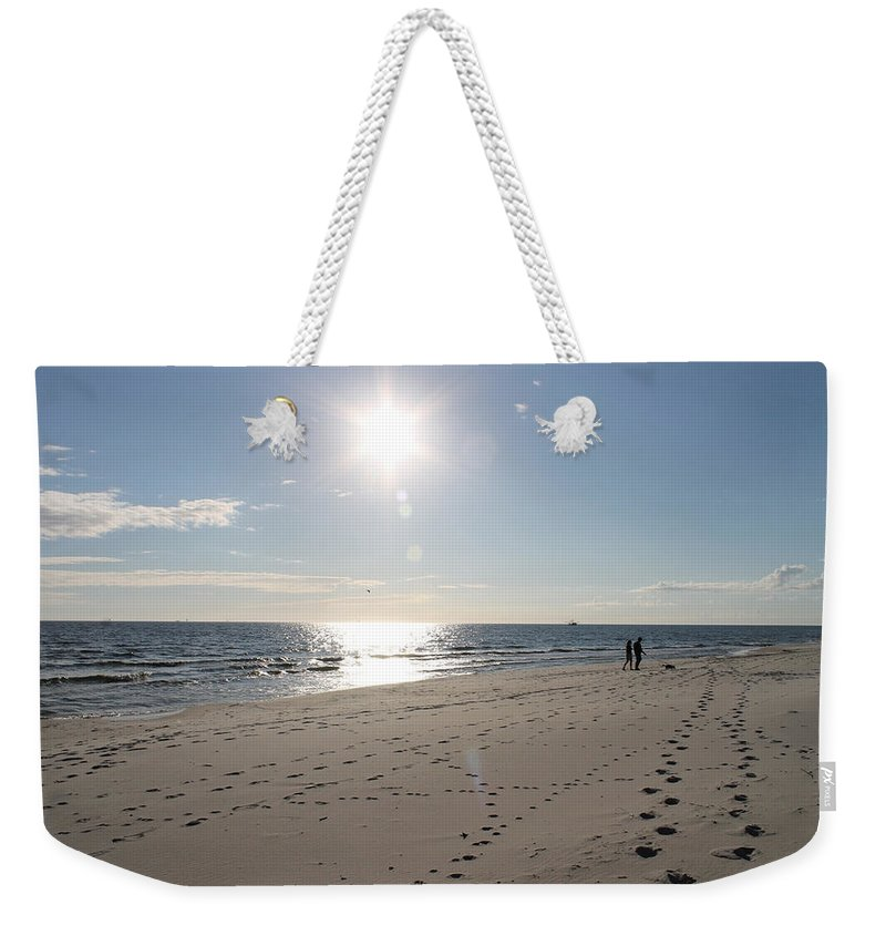 Beach Weekender Tote Bag featuring the photograph Island Beachwalkers by Laura Martin
