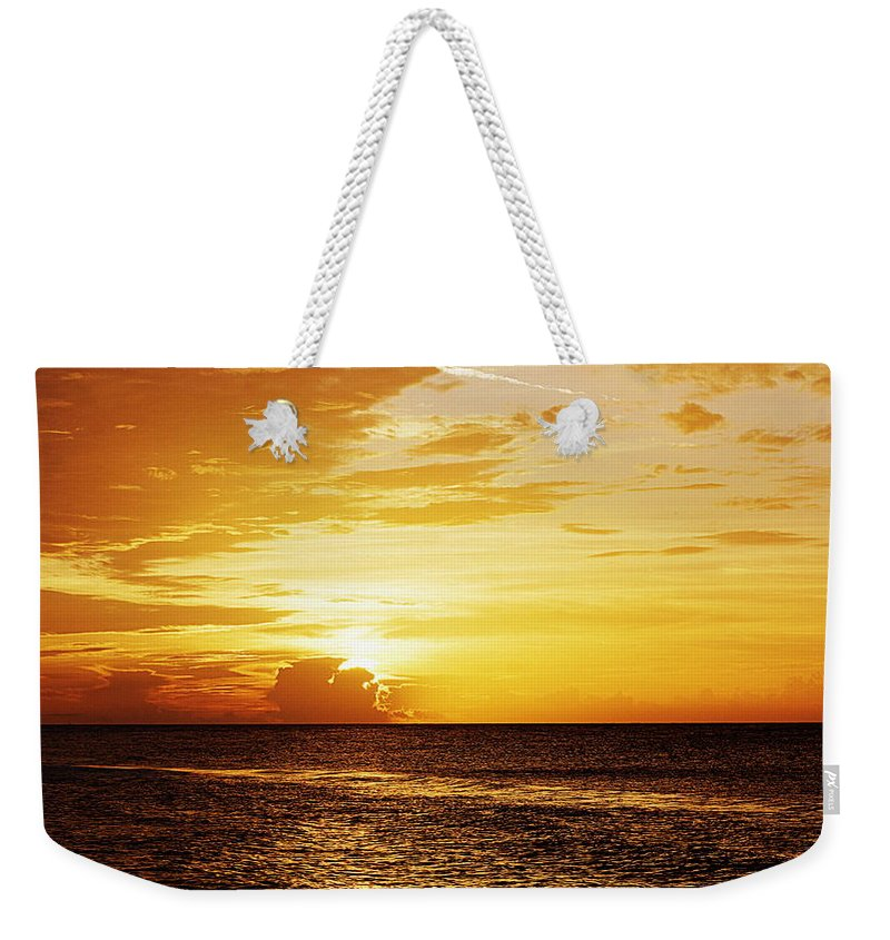 Sunrise Weekender Tote Bag featuring the photograph Island Sunrise by Paul Wilford