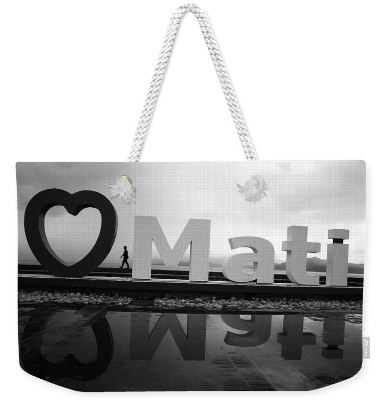 Mati Weekender Tote Bag featuring the photograph It Kinda Frows by Jez C Self