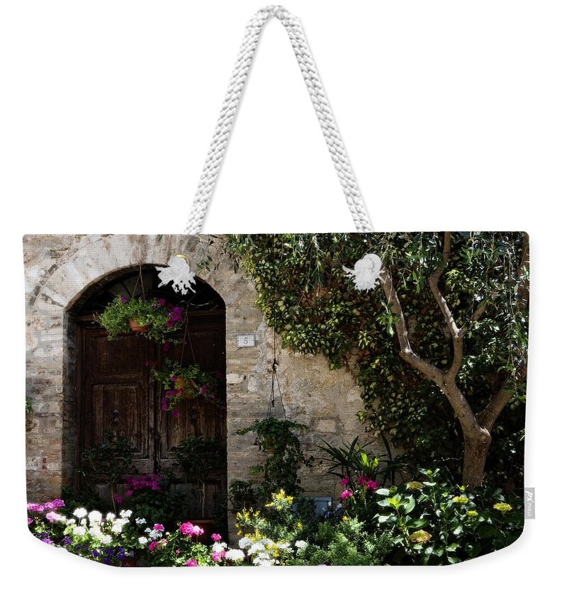 Flower Weekender Tote Bag featuring the photograph Italian Front Door Adorned With Flowers by Marilyn Hunt