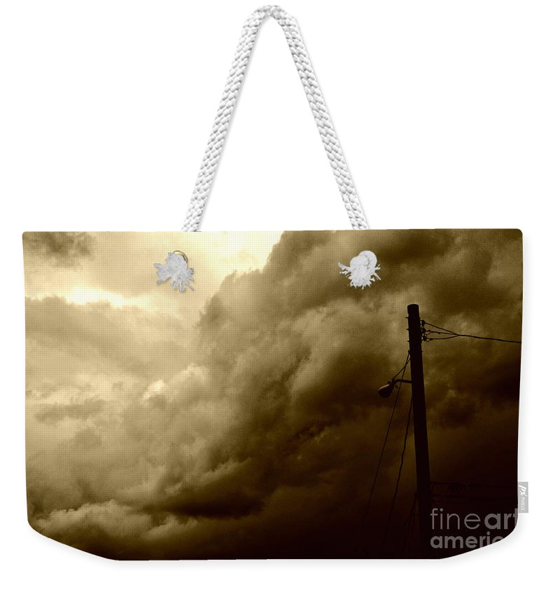 Clay Weekender Tote Bag featuring the photograph It's Coming by Clayton Bruster