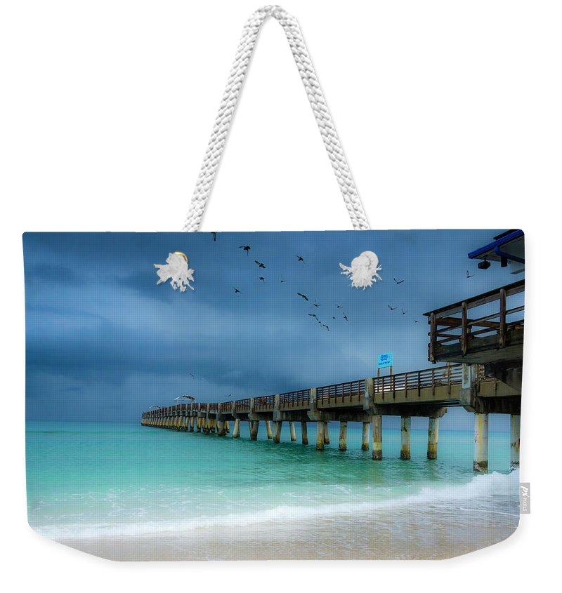 Pier Weekender Tote Bag featuring the photograph It's Getting Stormy At The Pier by Wolfgang Stocker