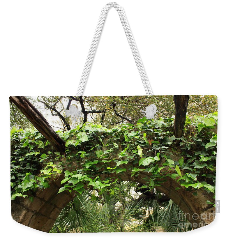 Ivy-covered Weekender Tote Bag featuring the photograph Ivy-covered Arch At The Alamo by Carol Groenen