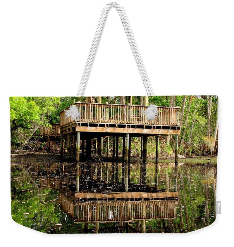 James E Grey Weekender Tote Bag featuring the photograph James E Grey Fishing Pier by Barbara Bowen