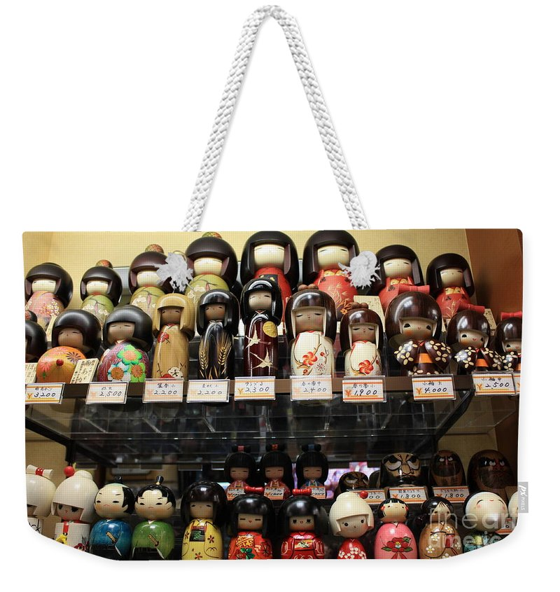 Japan Weekender Tote Bag featuring the photograph Japanese Dolls by Carol Groenen