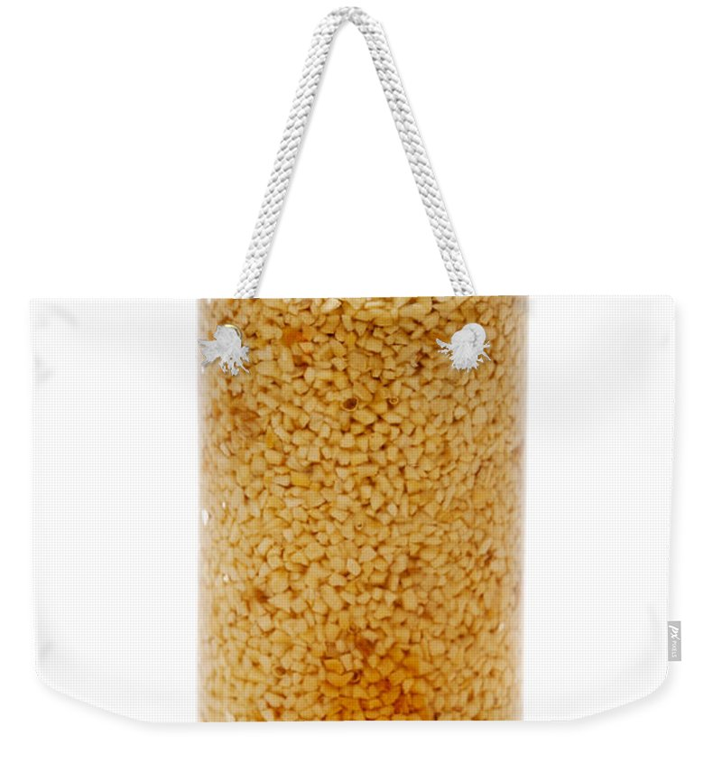 Garlic Weekender Tote Bag featuring the photograph Jar Of Minced Garlic And Clove by Donald Erickson