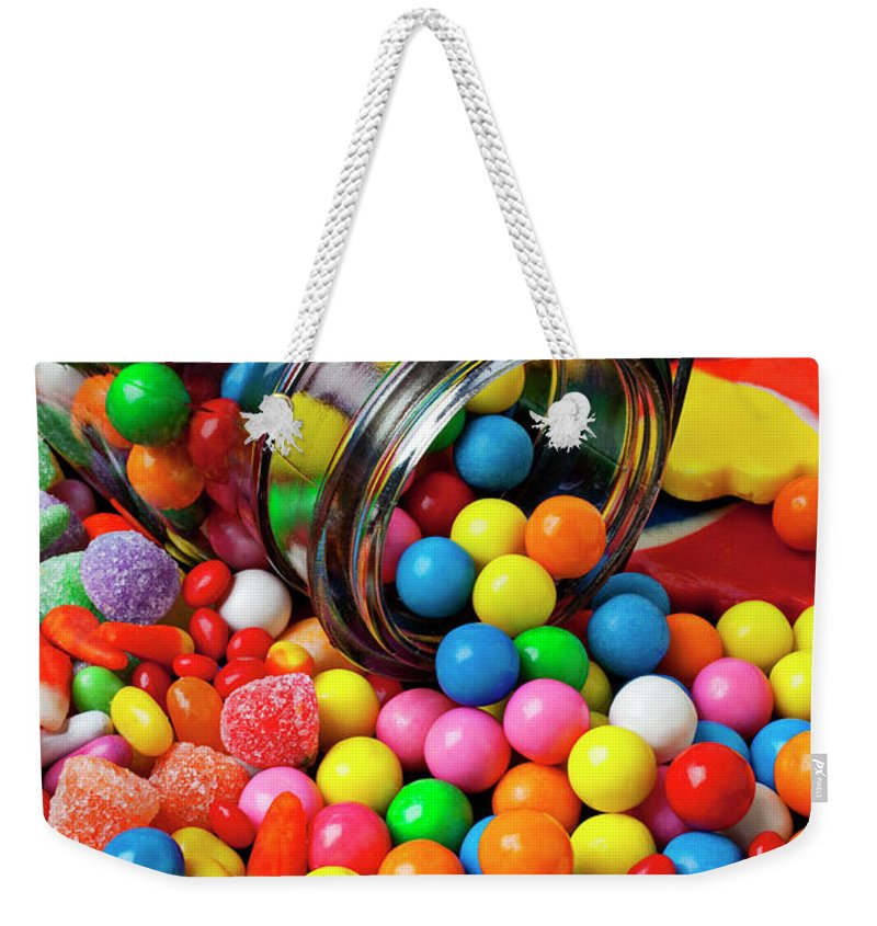 Jar Spilling Bubblegum Candy Concept Concept Conceptual Color Colour Colorful Weekender Tote Bag featuring the photograph Jar Spilling Bubblegum With Candy by Garry Gay
