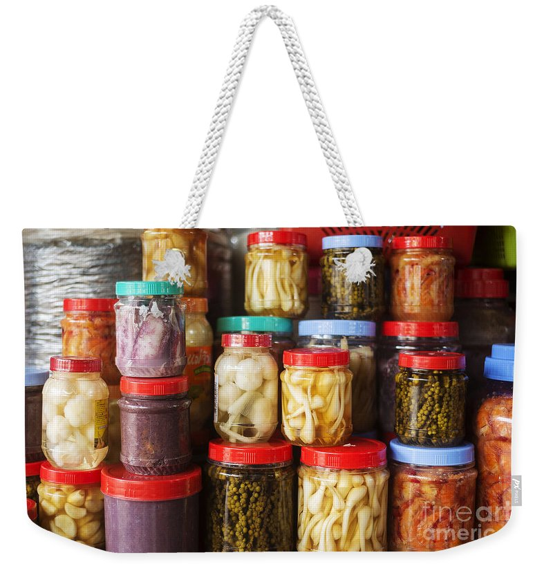 Asia Weekender Tote Bag featuring the photograph Jars Of Asian Style Pickles In Kep Market Cambodia by Jacek Malipan
