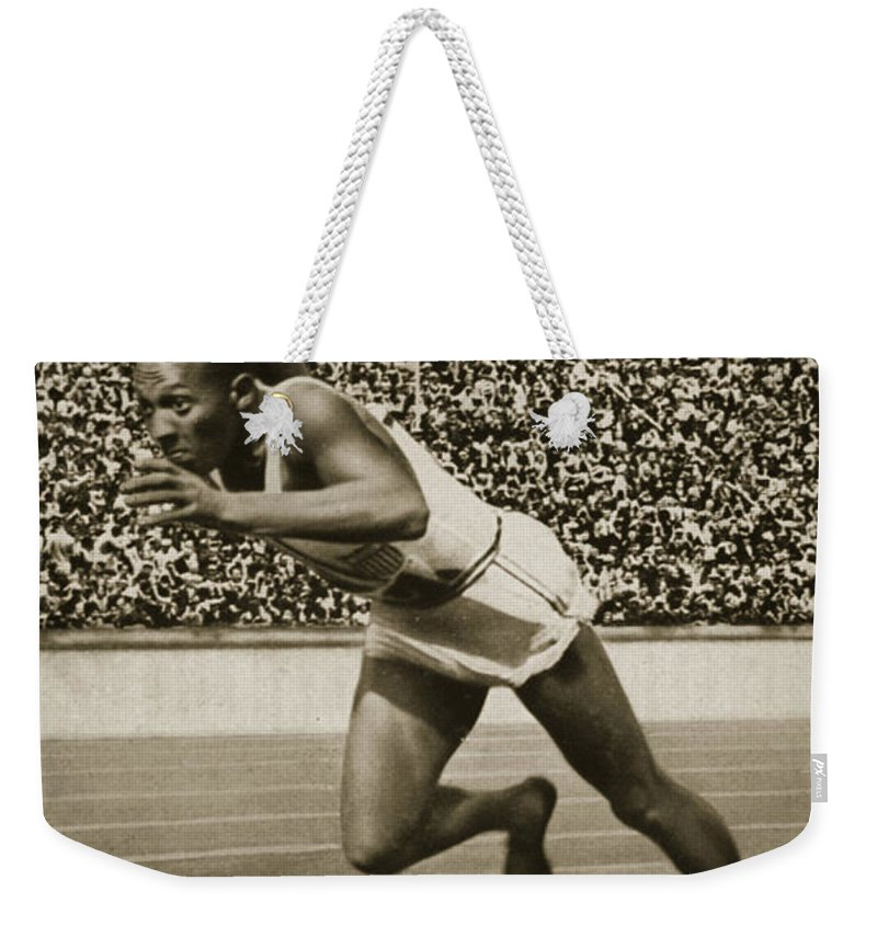 Sprinting; Sprint; Runner; Running; Winner; Champion; Stadium; Crowd; Stand; Male; Track; Competition; Speed Weekender Tote Bag featuring the photograph Jesse Owens by American School