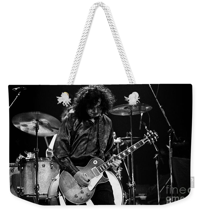 Robert Plant Weekender Tote Bag featuring the photograph Jimmy Page-0047 by Timothy Bischoff