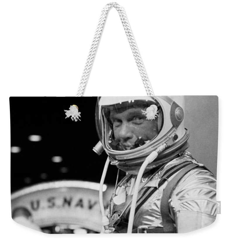 John Glenn Weekender Tote Bag featuring the photograph John Glenn Wearing A Space Suit by War Is Hell Store