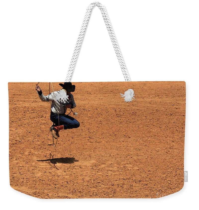 Western Art Weekender Tote Bag featuring the photograph Jump Rope Cowboy Style by Kim Henderson