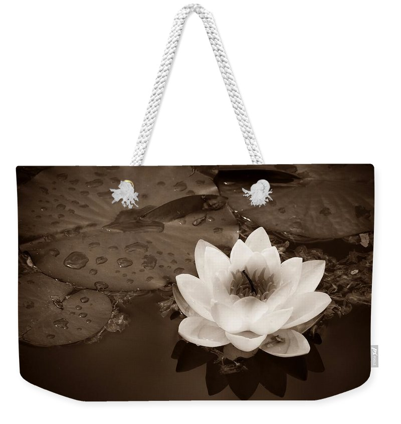 Lily Weekender Tote Bag featuring the photograph June 19 2010 by Tara Turner