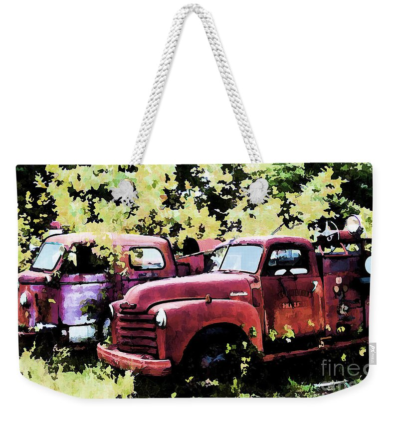 American La France Weekender Tote Bag featuring the digital art Junked Fire Engines by Tommy Anderson