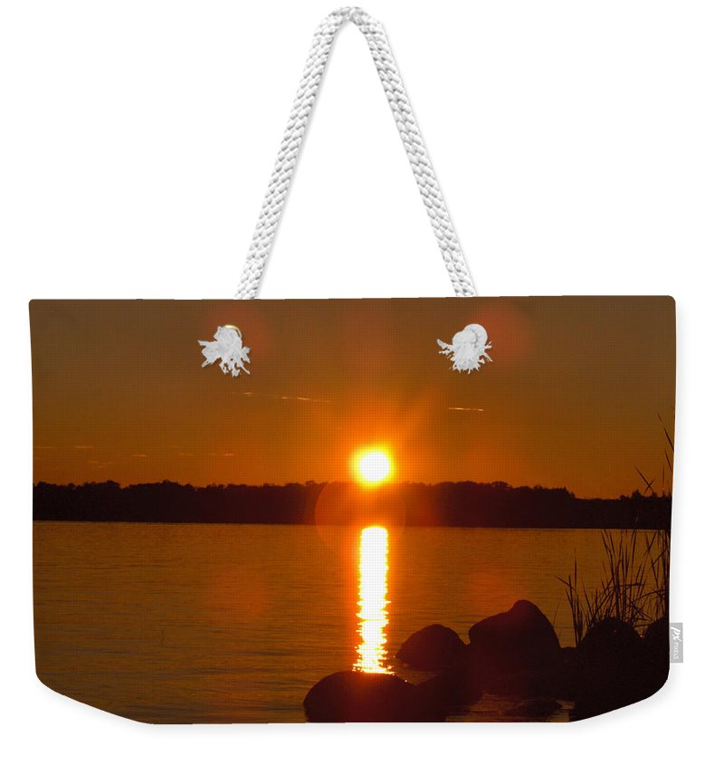 Beach Lake Rock Reeds Water Sky Weekender Tote Bag featuring the photograph Just Rock by Andrea Lawrence