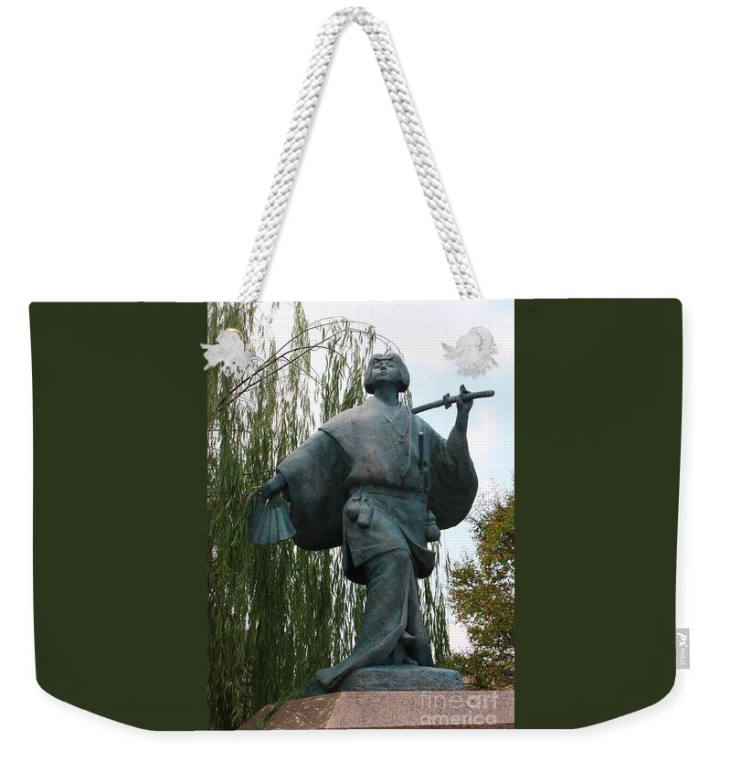 Kyoto Statue Weekender Tote Bag featuring the photograph Kabuki Dancer Statue In Kyoto by Carol Groenen