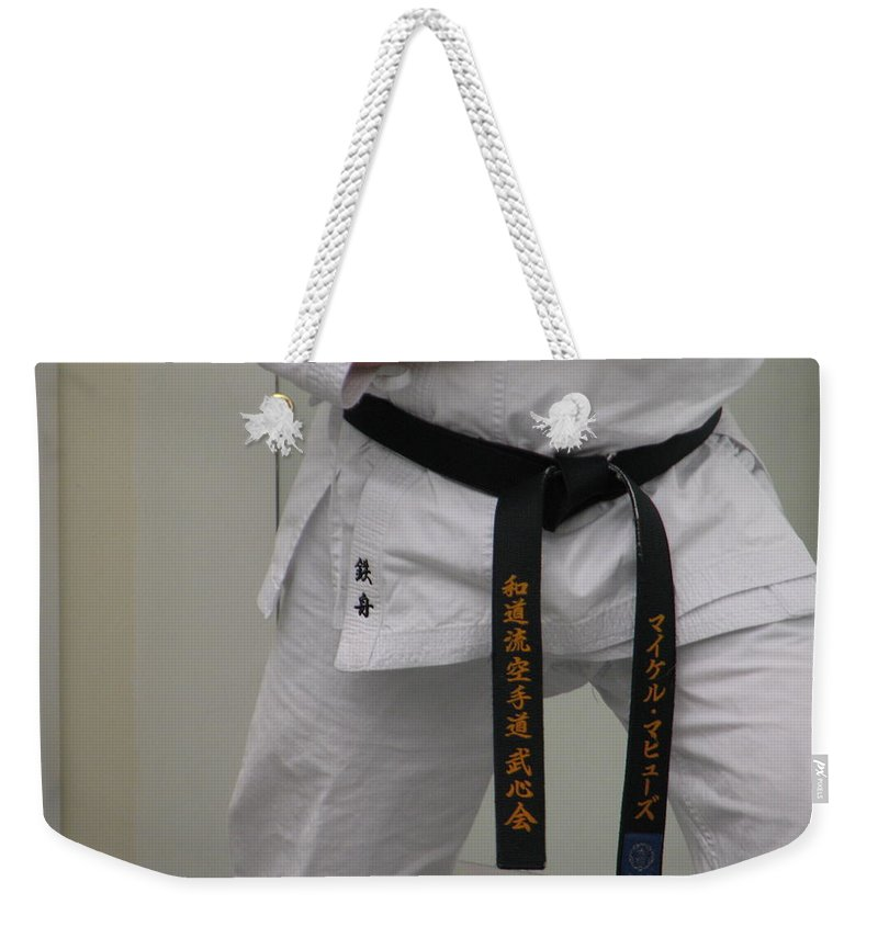 Karate Weekender Tote Bag featuring the photograph Kata by Kelly Mezzapelle