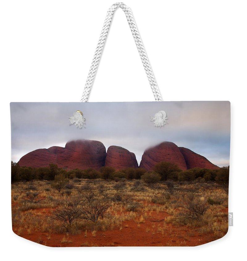 Kata Tjuta Weekender Tote Bag featuring the photograph Kata Tjuta Evening Glow by Mike Dawson