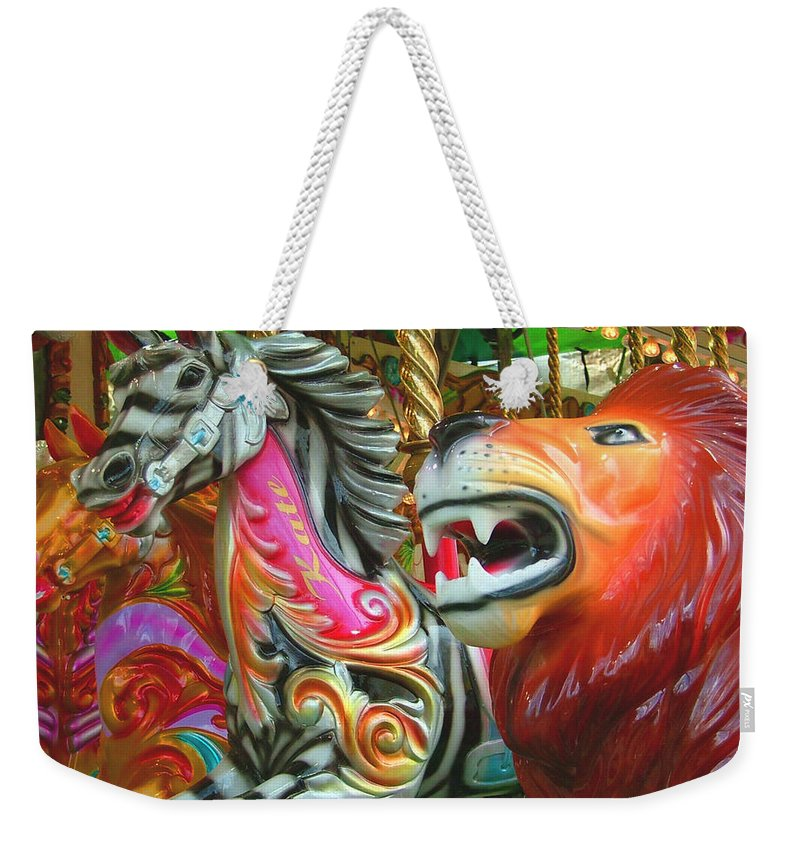 Zebra Weekender Tote Bag featuring the photograph Kate The Zebra And Lion Carousel by Heather Lennox