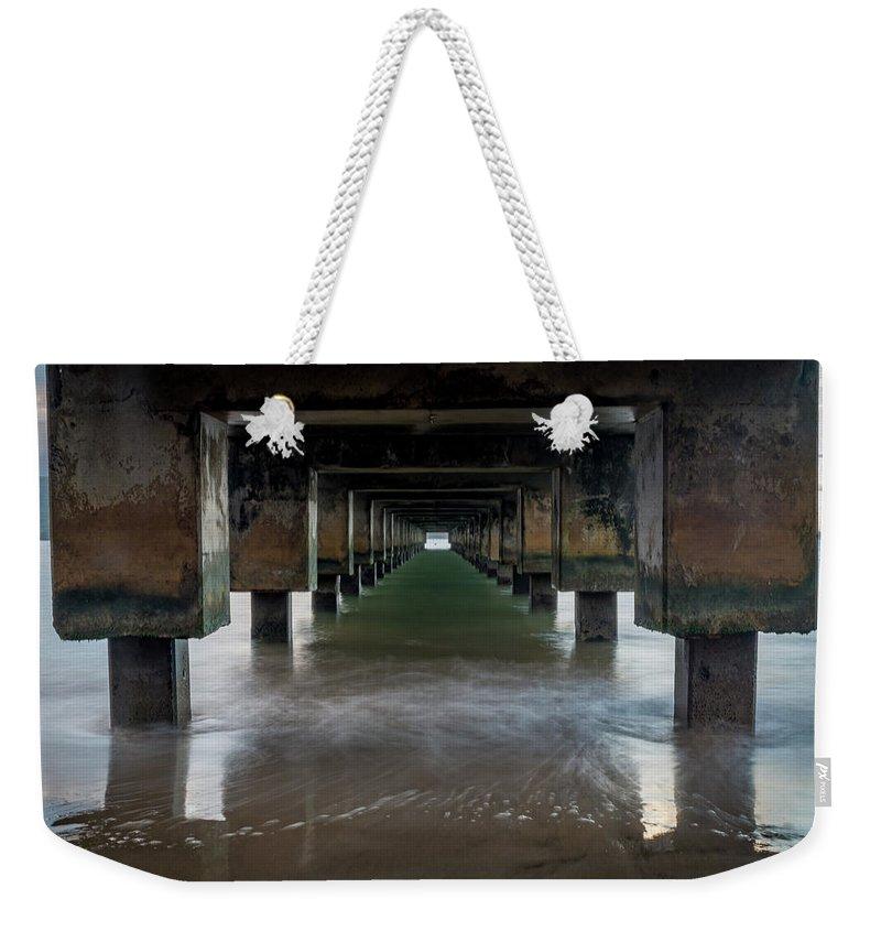 Pier Weekender Tote Bag featuring the photograph Kauai Pier by Gary Mosman
