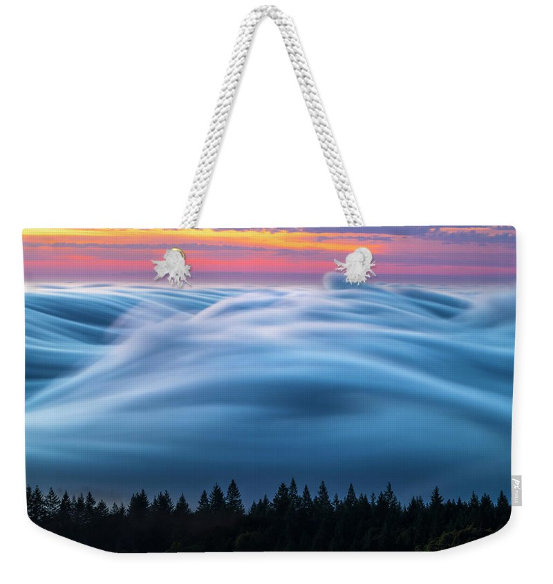 Cloud Inversion Weekender Tote Bag featuring the photograph Keep On Rolling by Alexander Davidovich