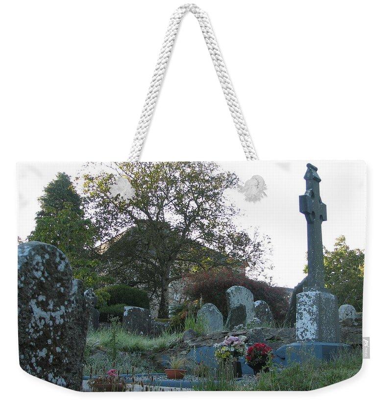 Graveyard Weekender Tote Bag featuring the photograph Kilmokea Graveyard by Kelly Mezzapelle