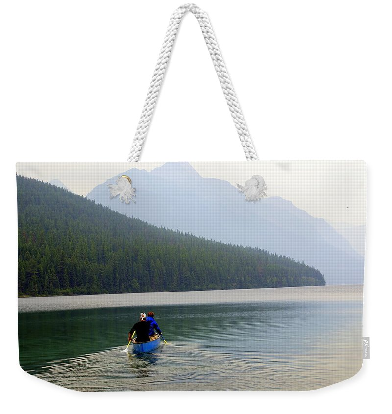 Mountains Weekender Tote Bag featuring the photograph Kintla Lake Paddlers by Marty Koch