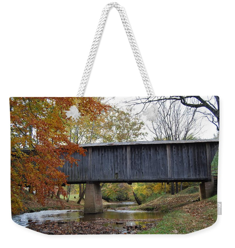 Landscape Weekender Tote Bag featuring the photograph Kissing Bridge At Fall by Eric Liller