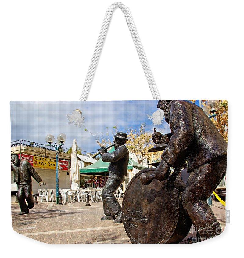 Kleizmer Weekender Tote Bag featuring the photograph Kleizmer Band In Bronze by Zal Latzkovich