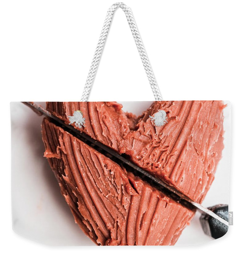 Food Weekender Tote Bag featuring the photograph Knife Cutting Heart Shape Chocolate On Plate by Jorgo Photography - Wall Art Gallery