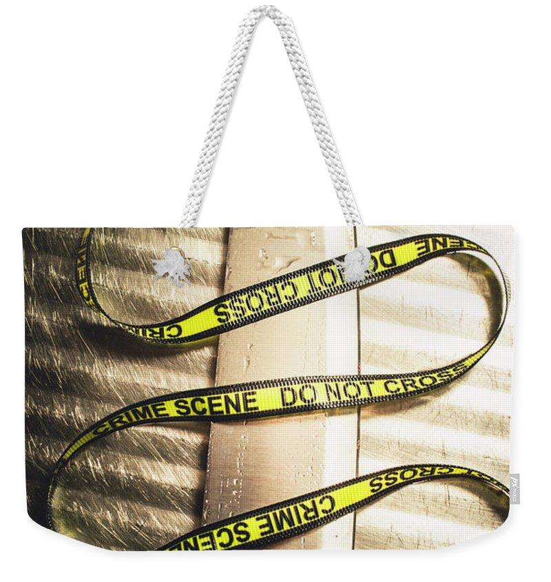 Forensic Weekender Tote Bag featuring the photograph Knife With Crime Scene Ribbon On Metal Surface by Jorgo Photography - Wall Art Gallery