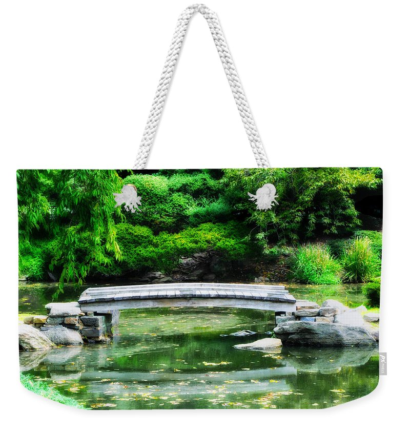 Koi Pond Weekender Tote Bag featuring the photograph Koi Pond Bridge - Japanese Garden by Bill Cannon
