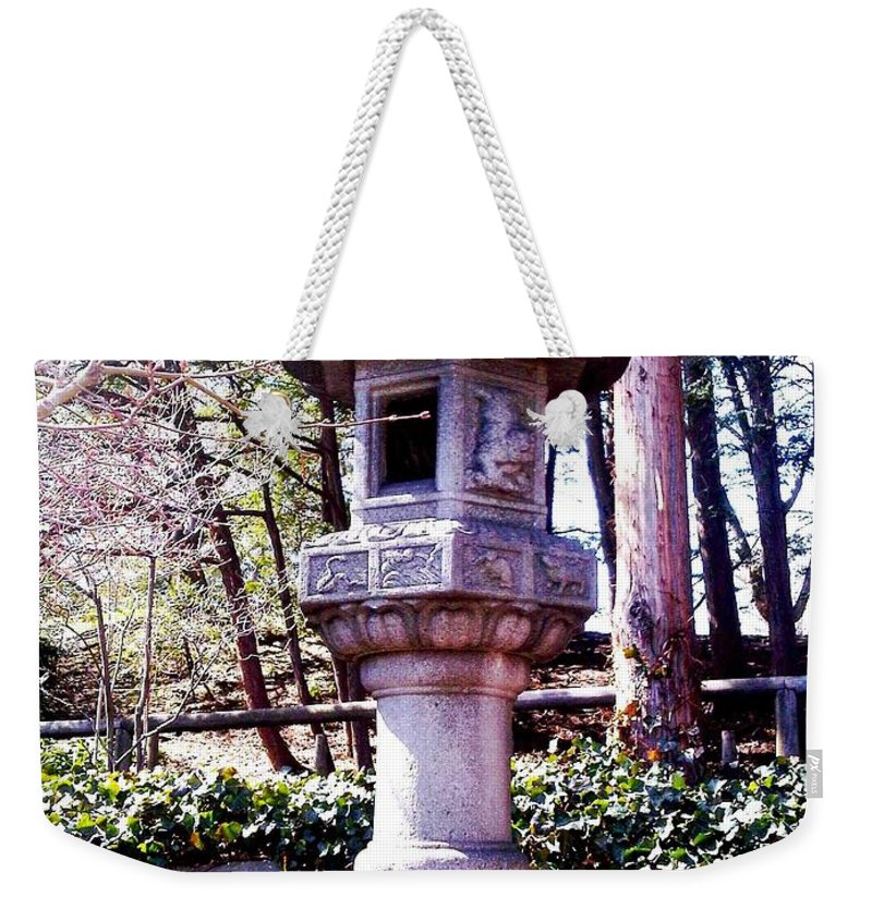 Bonsai Photo Weekender Tote Bag featuring the photograph Koi Pond Statue by Lord Frederick Lyle Morris