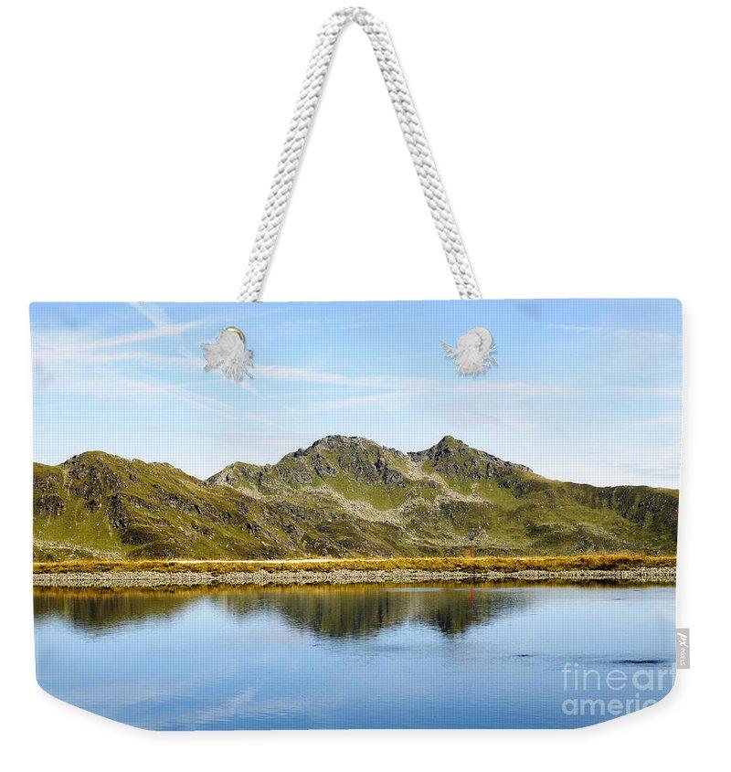 Underwater Spring Weekender Tote Bag featuring the photograph Konigsleiten Mountain Top. Tyrol, Austria by Ilan Rosen