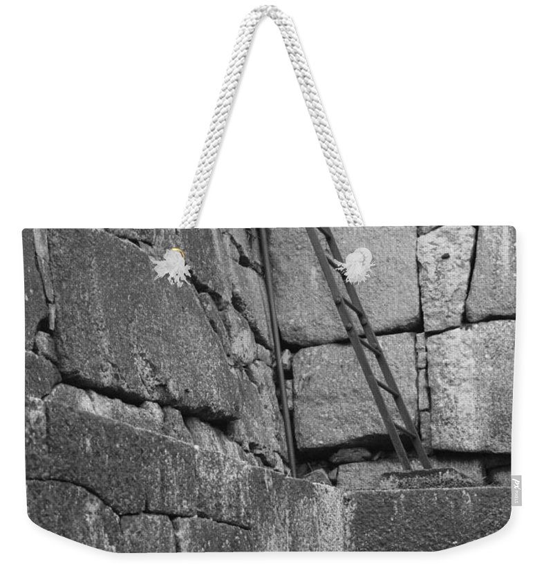 Black And White Weekender Tote Bag featuring the photograph Kyoto Palace Stone Wall by Carol Groenen
