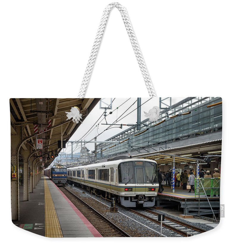 Escalator Weekender Tote Bag featuring the photograph Kyoto To Osaka Train Station, Japan by Perry Rodriguez