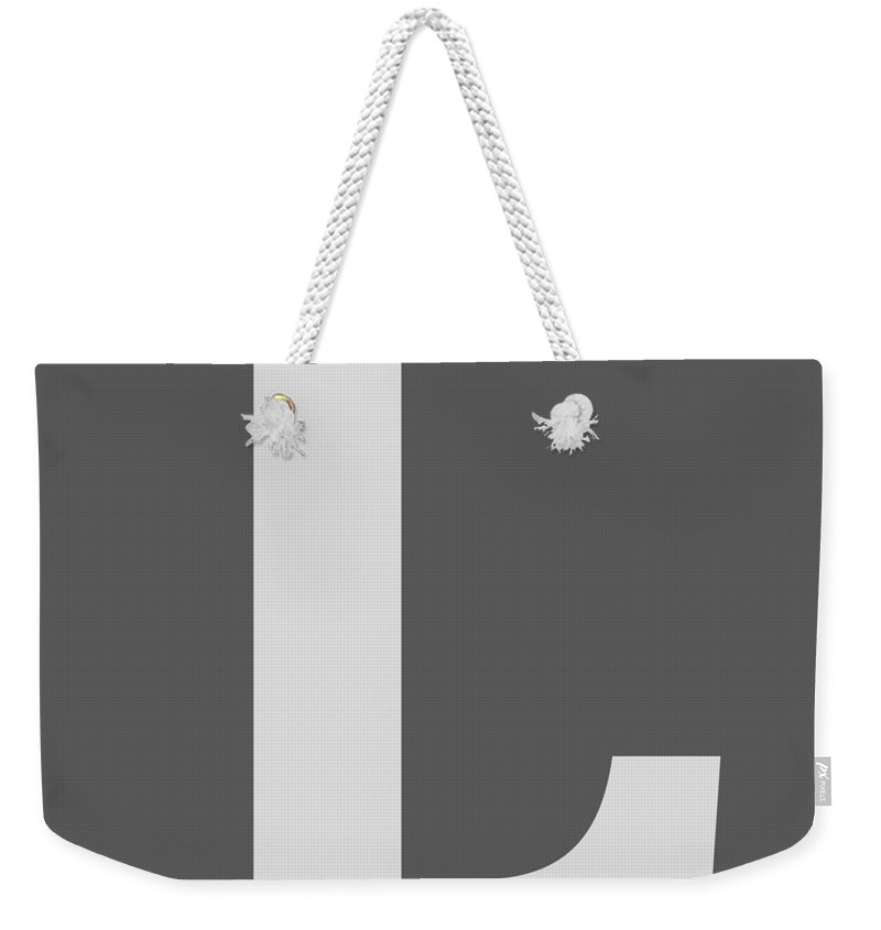 L Weekender Tote Bag featuring the digital art L In Light Gray Typewriter Style by Custom Home Fashions