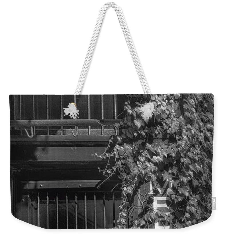La Buvette Weekender Tote Bag featuring the photograph La Buvette - Corner by Nikolyn McDonald