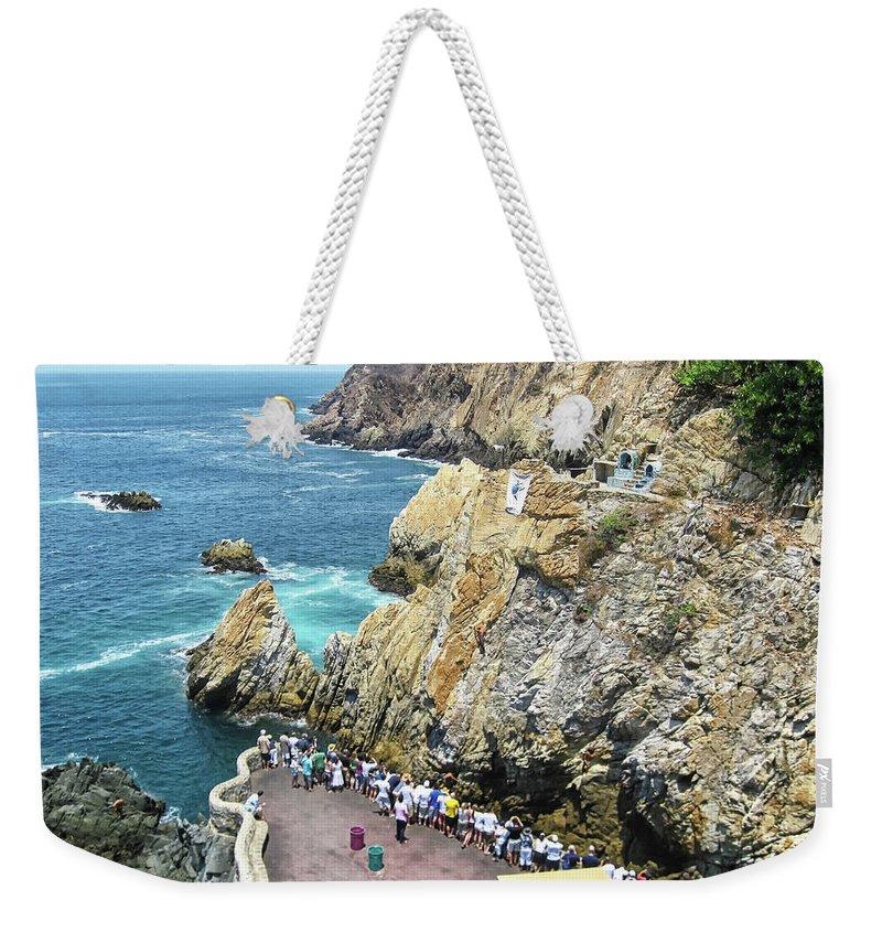 La Quebrada Weekender Tote Bag featuring the photograph La Quebrada by Tatiana Travelways