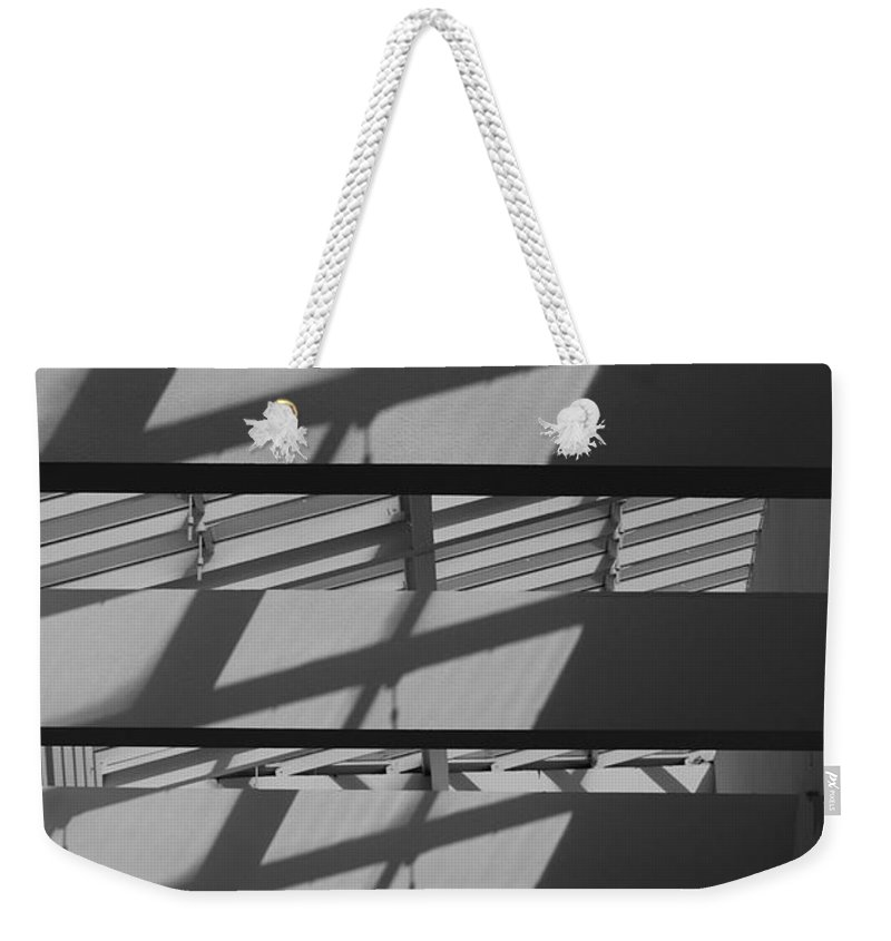 Black And White Weekender Tote Bag featuring the photograph Ladders In The Sky by Rob Hans