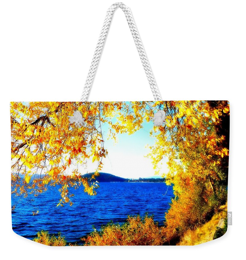 Lake Coeur D' Alene Weekender Tote Bag featuring the photograph Lake Coeur D'alene Through Golden Leaves by Carol Groenen